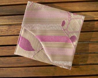 Pink pocket flap, beige, square format