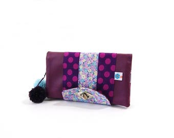 Purple wallet with polka dots and flowers