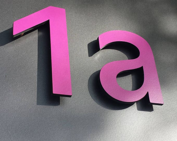 "Modern contemporary Coloured House numbers, 12""/300mm high in Antigoni font, standoff floating in resin board g"