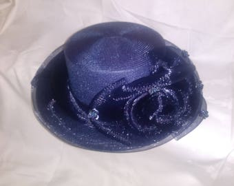 Navy blue straw hat with toole bow