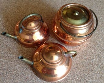 Set of three vintage minature copper and brass kettles and cooking pan with lids