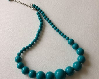 Necklace -  turquoise blue plastic bead necklace