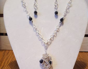 Silver wire wrapped pendent with Blue Glass beads and hand made chain