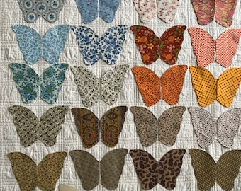 "Twenty fabric butterflies, 9"" wide, applique ready, edges turned and basted,circa 1970's, pattern included"