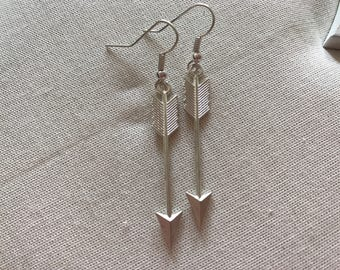 Long arrow silver coloured earrings end of line