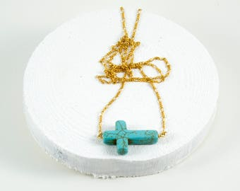 gold chain necklace with turquoise cross accent bead