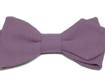 Purple bow backed with sharp edges