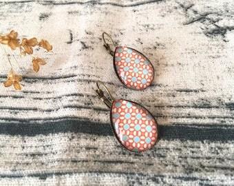 Bronze pendant earrings with fall pattern