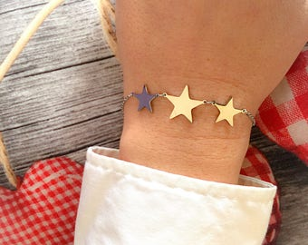 Steel bracelet with three star pendants