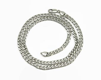 Sterling silver curb link necklace with flat links and parrot beak closure, stamped 925, 27 grams, 22 inches / 56 cm long
