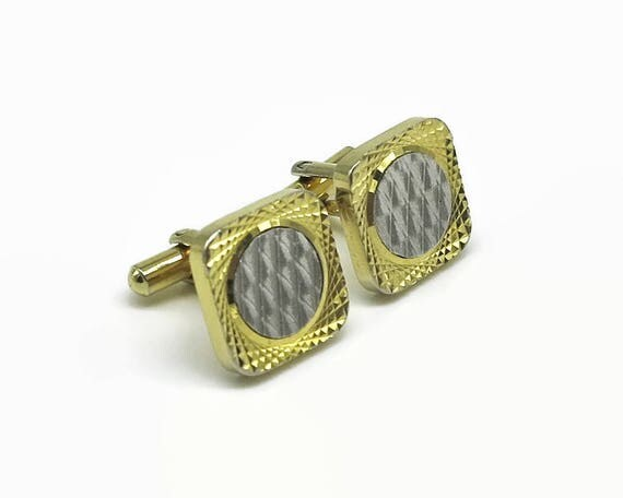 Vintage cuff links in gold and pewter tone metal, silver circle with gold border, engine turned patterns, circa 1960s