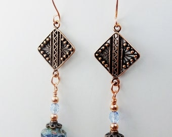 Unique Copper Boho Dangle Earrings with a Diamond Shaped Filigree Copper Link with Light Sapphire  Blue Saucer Beads.