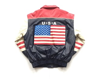 1980's Deadstock pleather polyvinyl USA big American Flag full zip button up jacket Steve And Barry's striped letterman varsity men's large