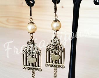 Earrings yellow glass pearl beads and bronze colored birdcage pendant