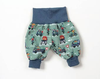 Baby boy harem pants. Comfy slouchy infant pants with fold over waistband and cuffs. Green cotton with lions, crocodiles, bicycles and cars
