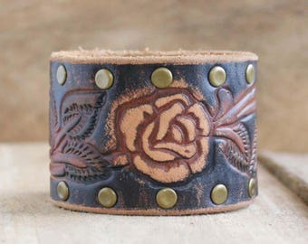 CUSTOM HANDSTAMPED wide black leather cuff with painted flower design and rivets by mothercuffer