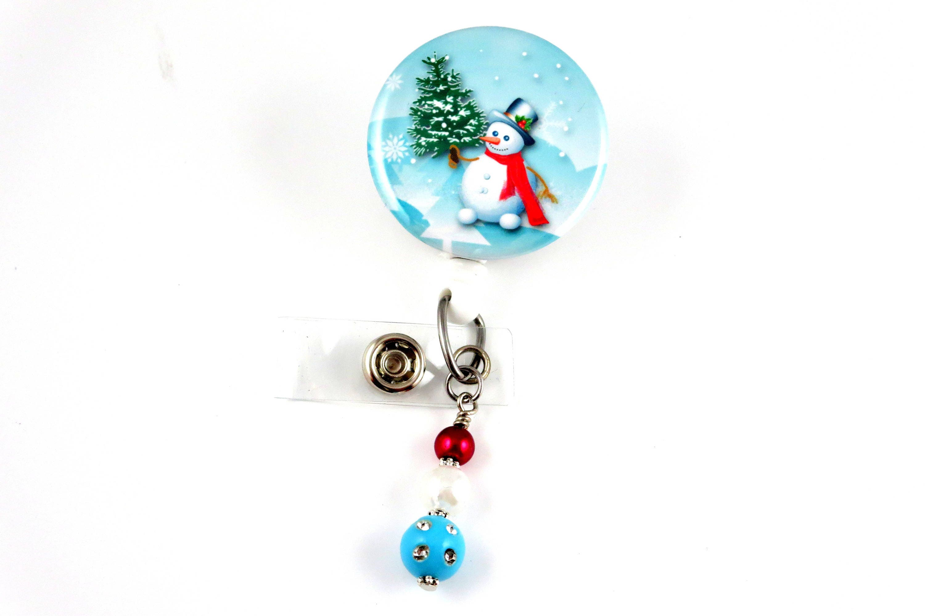 christmas snowman holding tree retractable id badge holder name