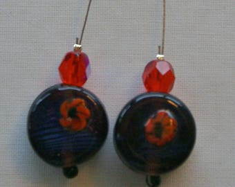 Earrings on steel wire with red and purple and red glass beads