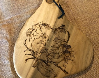 sweetlooking unique cutting boards. Beautiful FreeForm Black Gum Decorative Serving Cutting Board with hand  burned Squirrel and Bird Image Personalized Signs more by TheCarvingHorse on Etsy