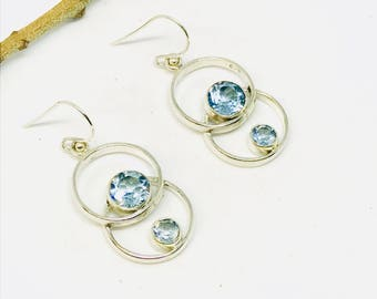 Blue Topaz earrings set in sterling silver 92.5. Length - 1.25 inch. Natural authentic blue topaz stones. Perfectly matched.