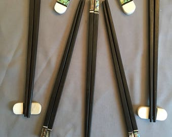 Ebony Chopstick with matching Green Abalone shell and matching pillow top rest. Set of 5
