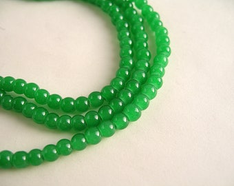 100 beads green round glass leaf 4mm