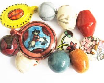 11 totally unique handmade ceramic beads. 23 mm - 60 mm