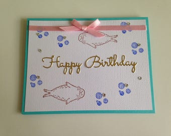 Summer Birthday Card with Seals swimming and Pink Ribbon