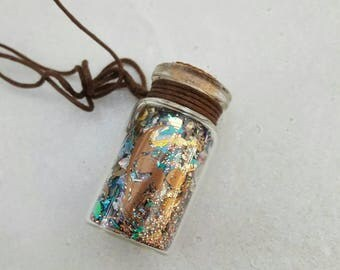 Potion bottle pendant.