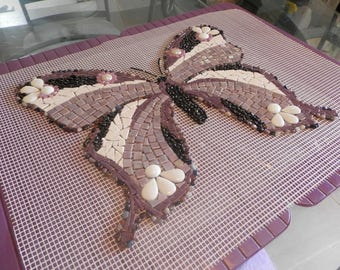 Purple, black and white mosaic butterfly on net