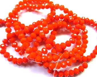 15 ROUND GLASS BEADS HAVE FACETED 6MM BLOOD ORANGE