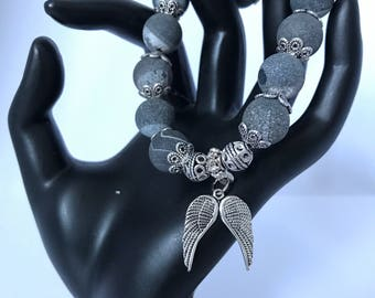 Black agate stone beaded stretch bracelet with feather wings