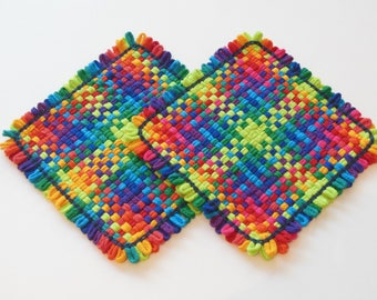 Two woven potholders, yellow, orange, green, and summer home decor,all cotton