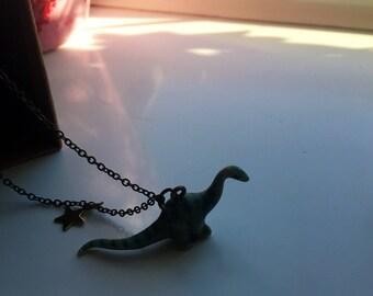Small dinosaur ceramic necklace
