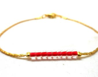 Gold minimalist bracelet, clear red beads