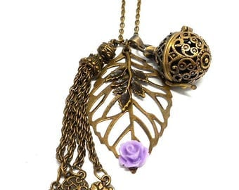 A scent! Necklace has perfume leaf, purple flower and tassel