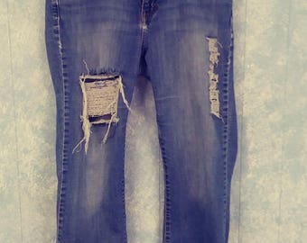 Calvin Klein All In One distressed jeans