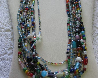 T- One Dozen Glass Mardi Gras bead necklaces from New Orleans-Carnival --Parade