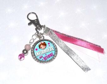 Jewelry bag/key fuschia nurse tearing ribbons, beads