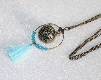Bola pregnancy/designer long necklace bronze with blue tassel and beads
