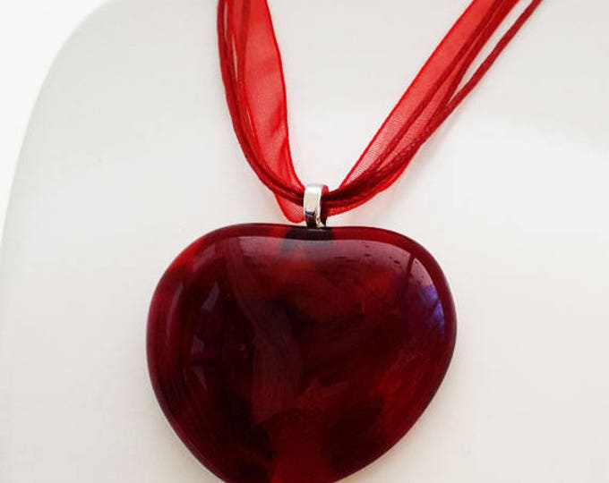 Red glass pendant, cast glass red and iridescent heart shape.