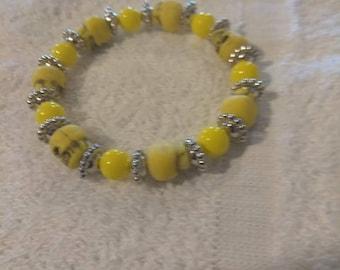 Yellow skull bracelet