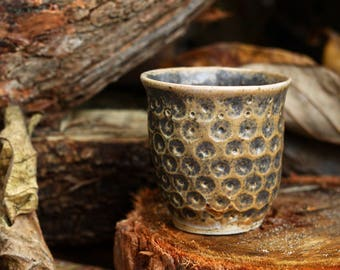 Stoneware Cup with acorn imprints in smooth matte glaze