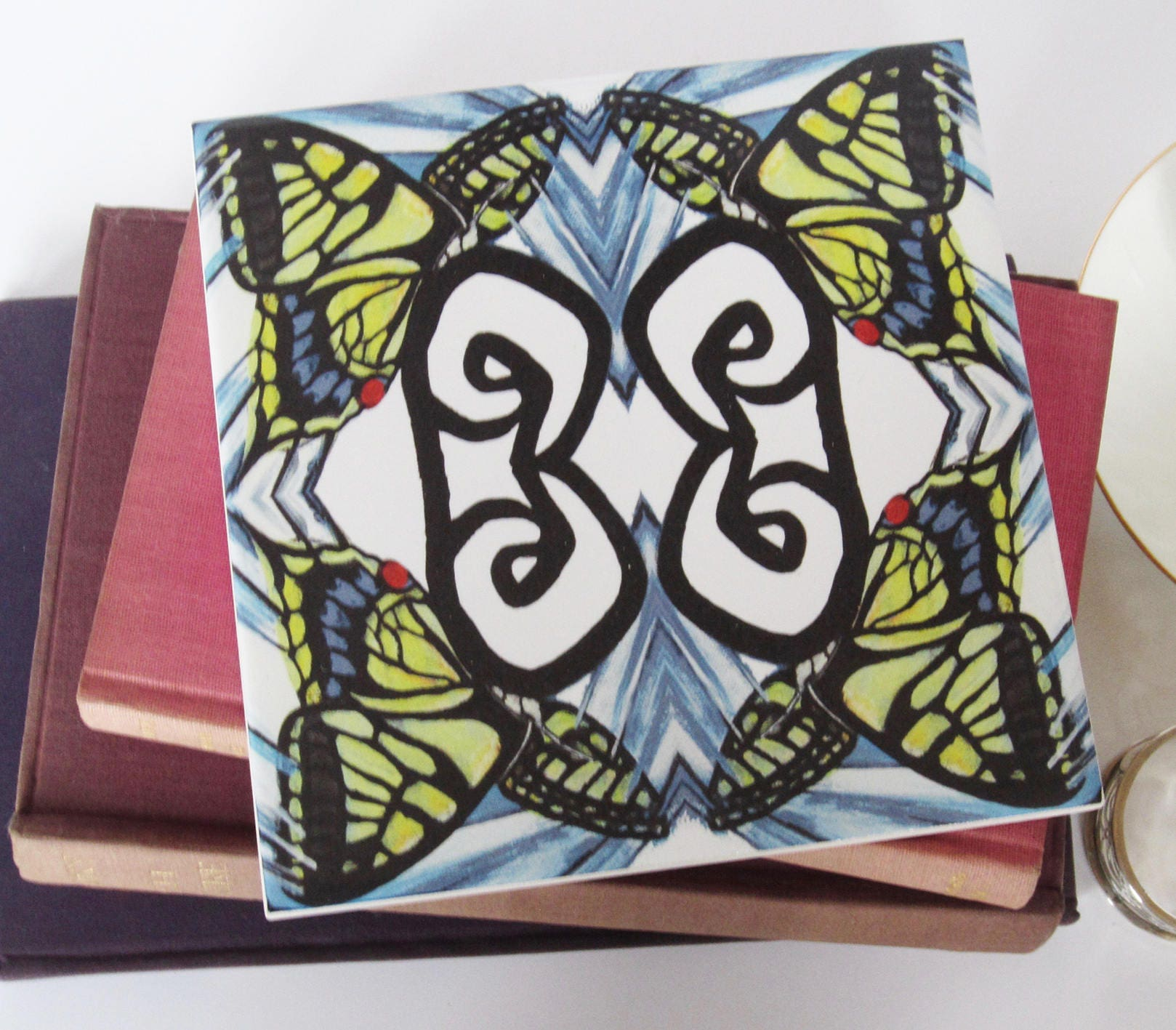 Geometric swallowtail butterfly design ceramic tile trivet with cork geometric swallowtail butterfly design ceramic tile trivet with cork backing from jacqueline talbot designs dailygadgetfo Choice Image