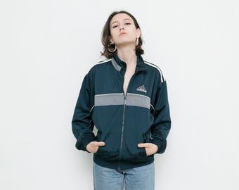 Vintage ADIDAS track jacket . Blue 3 three stripes windbreaker jacket . Big back Adidas  logo retro zip up sport jacket . Size S .