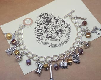 Witchcraft and Wizardry - Harry Potter inspired charm bracelet in Gryffindor house colours.