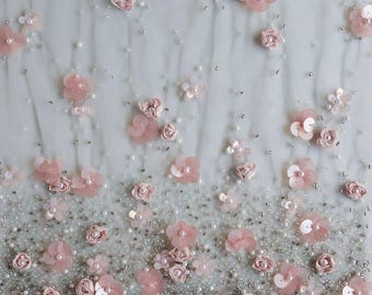Tulle hand-embroidered with ribbon and sequin flowers