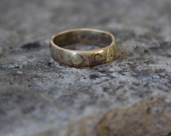 Raw 10k gold low dome band ring. Lightly hammered +textured and embedded with 10-14k gold. Hand crafted, made to order.
