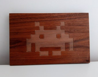 walnut space invader carving. 80s retro styling, vintage arcade art,