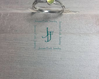 Silver and peridot wire ring